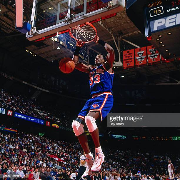 Patrick Ewing of the New York Knicks dunks against the Philadelphia 76ers during a game played circa 1996 at the Spectrum in Philadelphia...