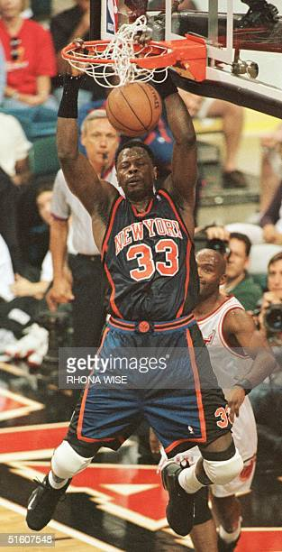 Patrick Ewing of the New York Knicks dunks the ball against the Miami Heat 16 May during game five of their 1st round playoff game at the Miami Arena...