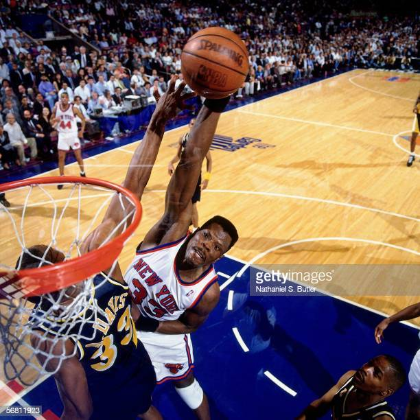Patrick Ewing of the New York Knicks goes up for a slam dunk against Antonio Davis of the Indiana Pacers during Game 1 of the Eastern Conference...