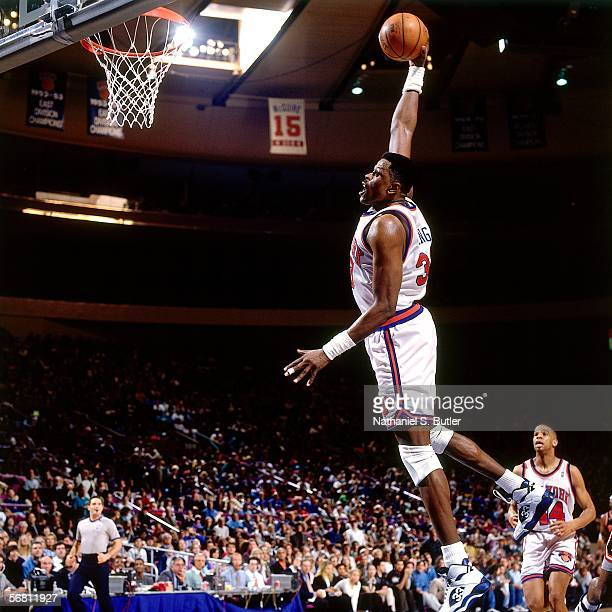 Patrick Ewing of the New York Knicks goes up for the slam dunk against the Miami Heat after on April 2, 1994 at Madison Square Garden in New York,...