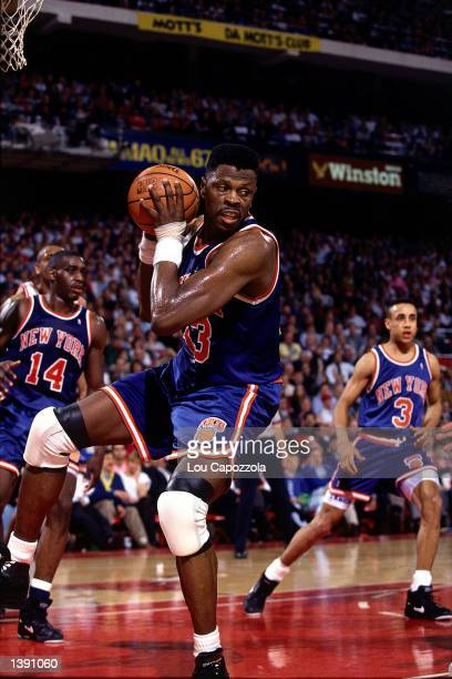 Patrick Ewing of the New York Knicks grabs a rebound against the Chicago Bulls during the first round of the 1991 NBA Playoffs at The Chicago Stadium...
