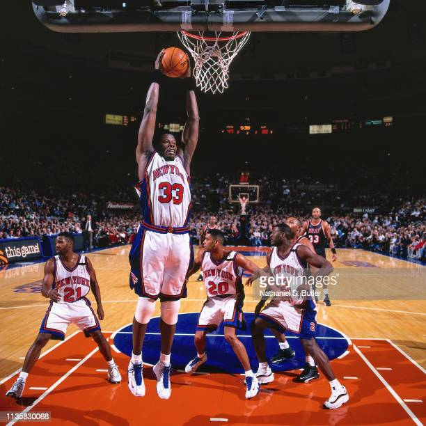 Patrick Ewing of the New York Knicks grabs the rebound against the Miami Heat on February 7 1999 at the Madison Square Garden in New York New York...