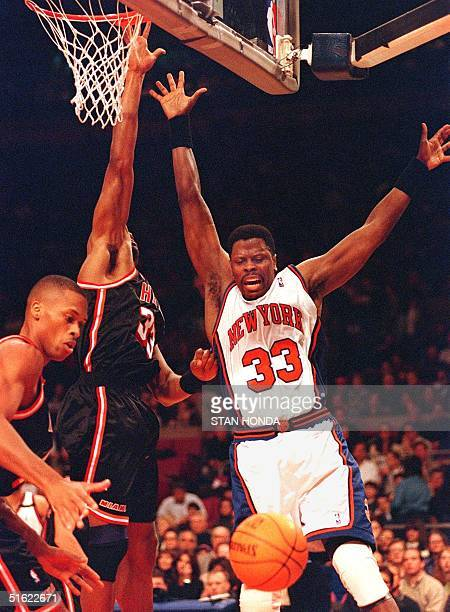 Patrick Ewing of the New York Knicks loses control of the ball while Alonzo Mourning of the Miami Heat and PJ Brown defend in the third quarter of...