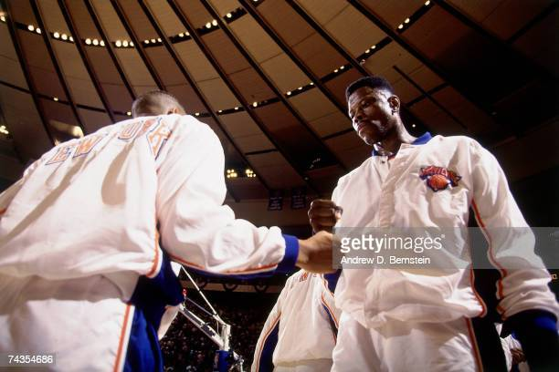 Patrick Ewing of the New York Knicks pumps fist with a teammate prior to Game Five of the NBA Finals played on June 17 1994 at Madison Square Garden...