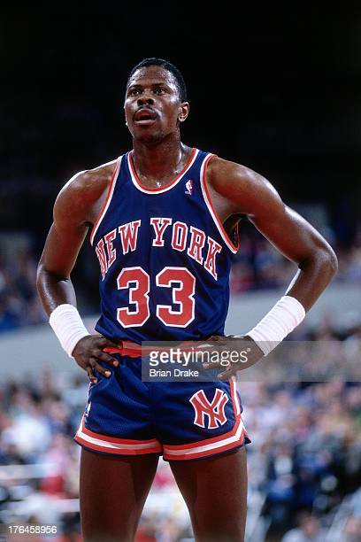 Patrick Ewing of the New York Knicks rests during a game against the Portland Trail Blazers played circa 1987 at the Veterans Memorial Coliseum in...