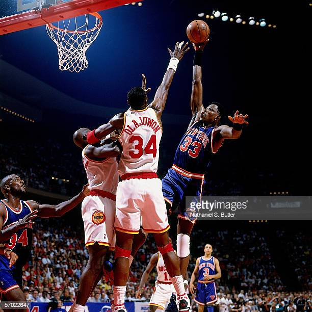 Patrick Ewing of the New York Knicks shoots a hookshot in the paint against Hakeem Olajuwon of the Houston Rockets during a 1994 NBA game at the...