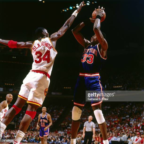 Patrick Ewing of the New York Knicks shoots against Hakeem Olajuwon of the Houston Rockets during Game Seven of the NBA Finals played on June 22 1994...