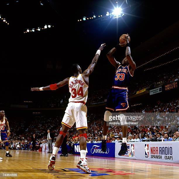Patrick Ewing of the New York Knicks shoots against Hakeem Olajuwon of the Houston Rockets during Game Seven of the 1994 NBA Finals at the Summit on...