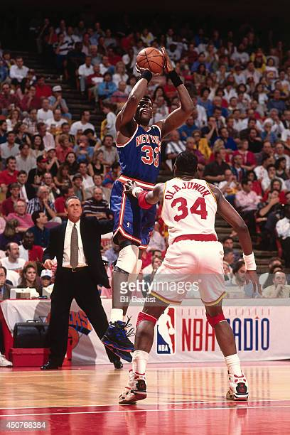 Patrick Ewing of the New York Knicks shoots the ball during Game One of the NBA Finals against Hakeem Olajuwon of the Houston Rockets on June 8 1994...