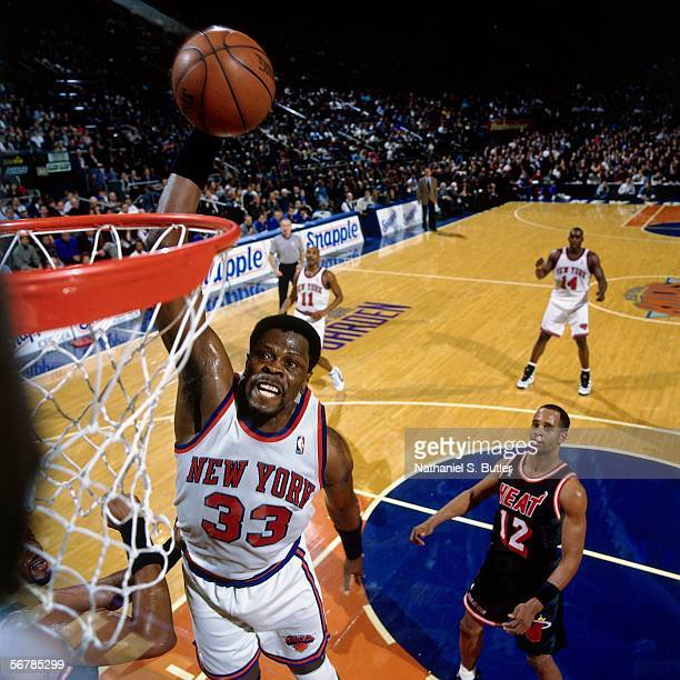 Patrick Ewing of the New York Knicks slam dunks against Bimbo Coles of the Miami Heat on January 29 1996 at Madison Square Garden in New York New...