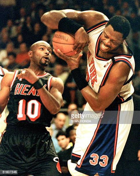 Patrick Ewing of the New York Knicks struggles with a rebound as Tim Hardaway of the Miami Heat defends in the first quarter of the fourth game of...