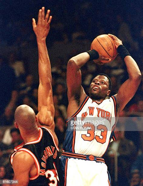 Patrick Ewing of the New York Knicks tries to shoot over the arm of Alonzo Mourning of the Miami Heat in the third quarter of the fourth game of...