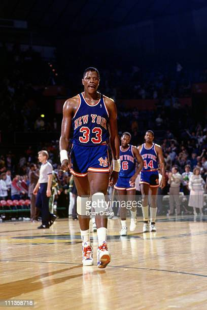 Patrick Ewing of the New York Knicks walks against the Portland Trailblazers at the Veterans Memorial Coliseum in Portland Oregon circa 1988 NOTE TO...