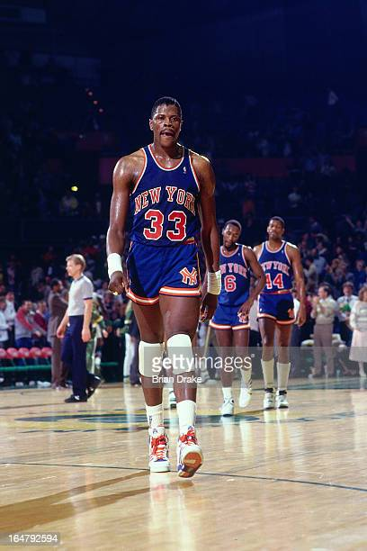 Patrick Ewing of the New York Knicks walks against the Portland Trail Blazers during a game played circa 1987 at the Veterans Memorial Coliseum in...