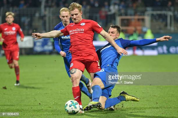 Patrick Fabian of Bochum tackles Andreas Voglsammer of Bielefeld during the Second Bundesliga match between VfL Bochum 1848 and DSC Arminia Bielefeld...