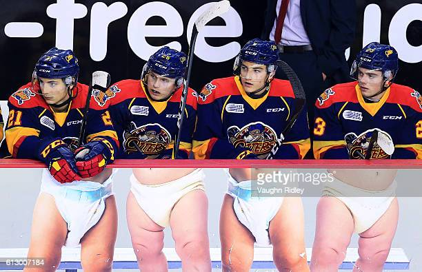 Patrick Fellows Allan McShane Carson Edwardson and Shaun Bily of the Erie Otters sit on the bench during the first period of an OHL game against the...