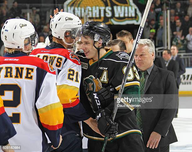 Patrick Fellows of the Erie Otters congratulates Mitchell Marner of the London Knights after the Knights won the OHL Western Conference Final on...