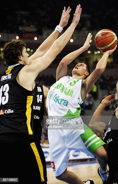 Patrick Femerling from Germany guards Jaka Lakovic from Slovenia during the FIBA EuroBasket 2005 quarter final match between Slovenia and Germany on...