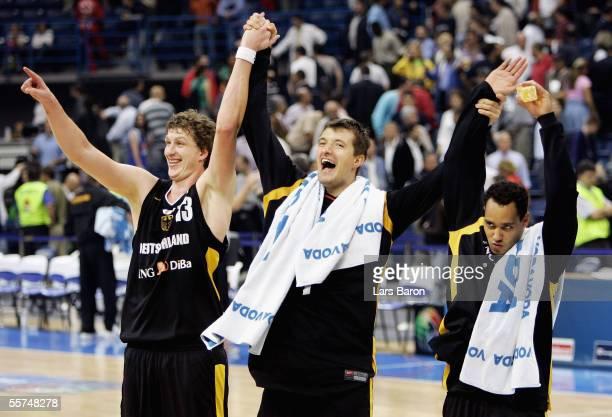 Patrick Femerling, Robert Maras and Robert Garret celebrate winning the FIBA EuroBasket 2005 quarter final match between Slovenia and Germany on...