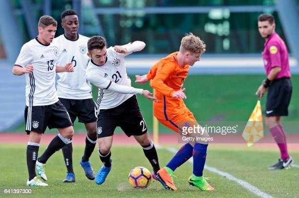 Patrick Finger MatondoMerveille Papela and Erkan Eyibil of Germany U16 challenges Vincent Schippers of Netherlands U16 during the UEFA Development...