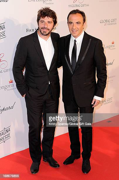 Patrick Fiori and Nikos Aliagas attend the 'Global Gift Gala' at Hotel George V on May 13 2013 in Paris France