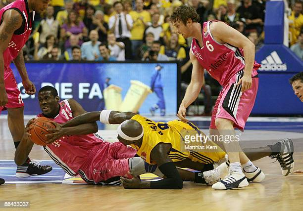 Patrick Flomo of Bonn and Ansu Seasay of Berlin challenge for the ball during the BBL PlayOffs fifth semifinal match between Alba Berlin and Telekom...