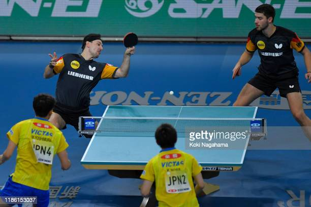 Patrick Franziska and Timo Boll of Germany competes againast Koki Niwa and Maharu Yoshimura of Japan during Men's Teams singles - Quarterfinals -...