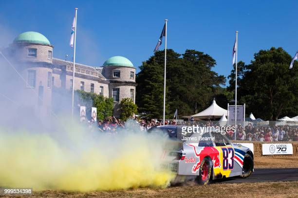 Patrick Friesacher of Austria performs donuts in the Red Bull Racing NASCAR during the Goodwood Festival of Speed at Goodwood on July 15 2018 in...