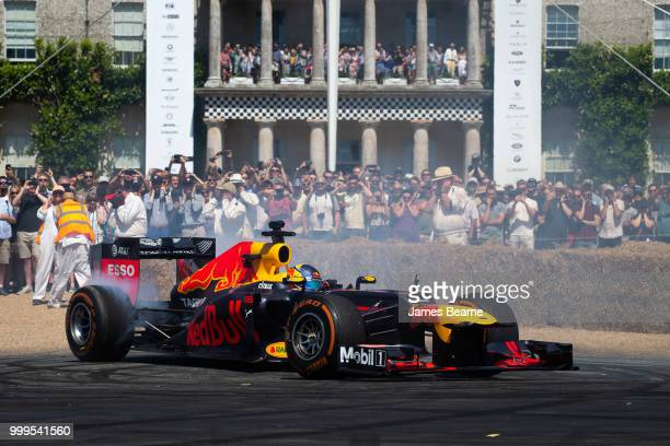 Patrick Friesacher of Austria performs donuts in the Red Bull Racing RB8 during the Goodwood Festival of Speed at Goodwood on July 15 2018 in...