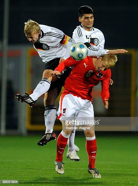 Patrick Funk and Taner Yalcin of Germany battle for the ball with Thomas Hopper of Austria during the U20 International Friendly match between...