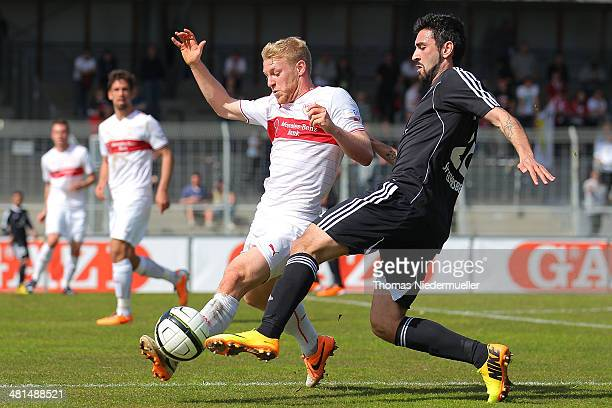 Patrick Funk of Stuttgart fights for the ball with Couthino Pinheiro of Elversberg during the third Bundesliga match between VfB Stuttgart II and SV...