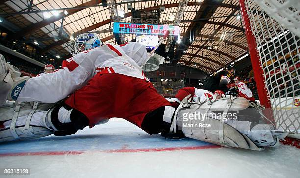 Patrick Galbraith goalkeeper of Denmark saves the puck during the IIHF World Ice Hockey Championship relegation round match between Germany and...