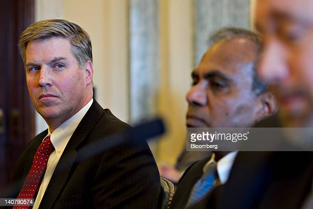 Patrick Gallagher, director of the National Institute of Standards and Technology , left, looks on as Mason Peck, chief technologist with the...