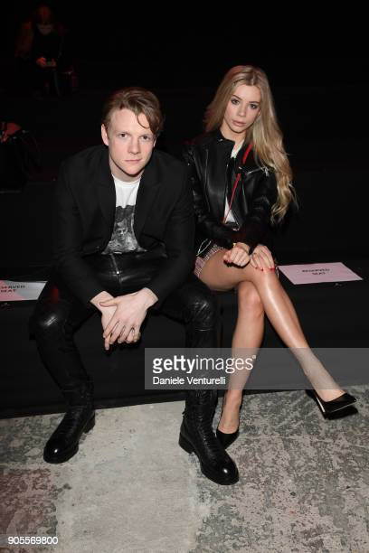 Patrick Gibson and Joanna Kuchta attend the Dsquared2 show during Milan Menswear Fashion Week Fall/Winter 2018/19 on January 14 2018 in Milan Italy