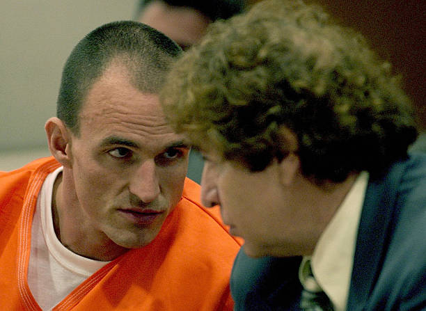 Patrick Graber, talks with his attorney Peter Knecht in Los Angeles County Superior Court, 29 September 2003. Graber, a Swiss body-building coach was...