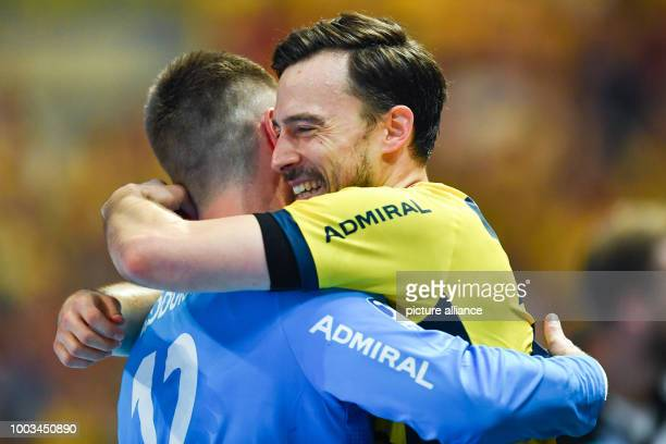 Patrick Groetzki and goalie Andreas Palicka of the RheinNeckar Loewen celebrate becoming champions after the Bundesliga handball match between...