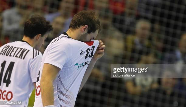 Patrick Groetzki and Steffen Faeth of Germany react after the men's Handball World Championships quarterfinal match Spain vs Germany in Saragossa...