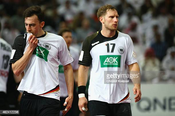 Patrick Groetzki and Steffen Weinhold of Germany look dejected during the quarter final match between Qatar and Germany at Lusail Multipurpose Hall...
