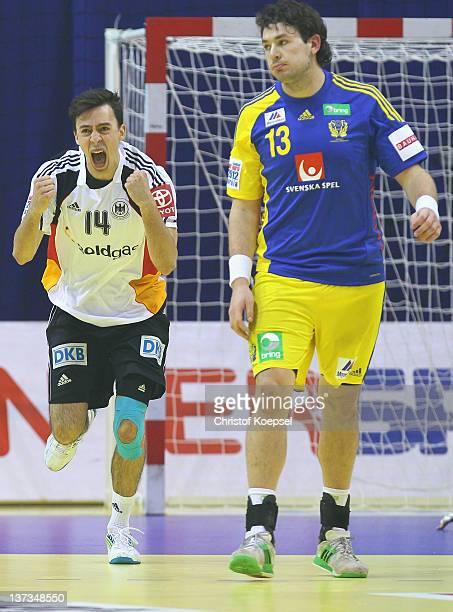 Patrick Groetzki of Germany celebrates a goal and Jonathan Stenbaecken of Sweden looks dejected during the Men's European Handball Championship group...