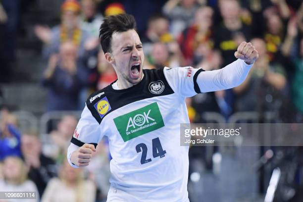 Patrick Groetzki of Germany celebrates a goal during the 26th IHF Men's World Championship group 1 match between Germany and Iceland at Lanxess Arena...