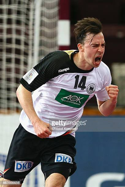 Patrick Groetzki of Germany celebrates a goal during the eighth place match between Germany and Slovenia in the Men's Handball World Championship at...
