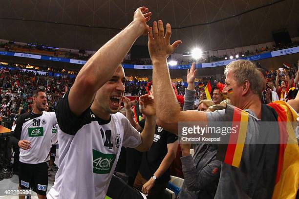 Patrick Groetzki of Germany celebrates with the fans after the eight final match between Germany and Egypt at Lusail Multipurpose Hall on January 26...