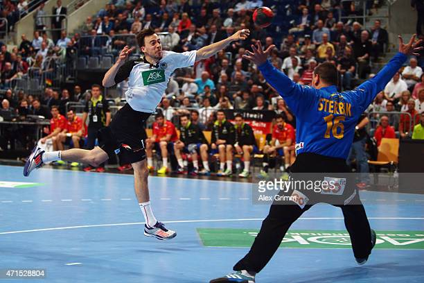 Patrick Groetzki of Germany scores a goal against goalkeeper Arpad Sterbik Capar of Spain during the European Handball Championship 2016 Qualifier...