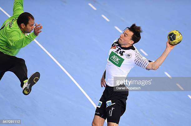 Patrick Groetzki of Germany scores during the Handball International Friendly match between Germany and Tunisia at Porsche Arena on July 13 2016 in...