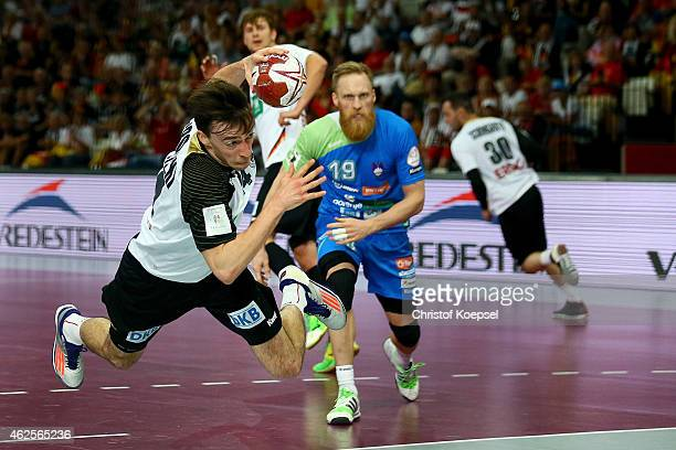 Patrick Groetzki of Germany throws the ball during the eighth place match between Germany and Slovenia in the Men's Handball World Championship at...