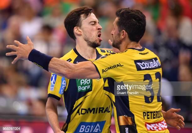 Patrick Groetzki of RheinNeckar celebrates with Alexander Petersson during the final of the DKB Handball Bundesliga Final Four between Hannover and...