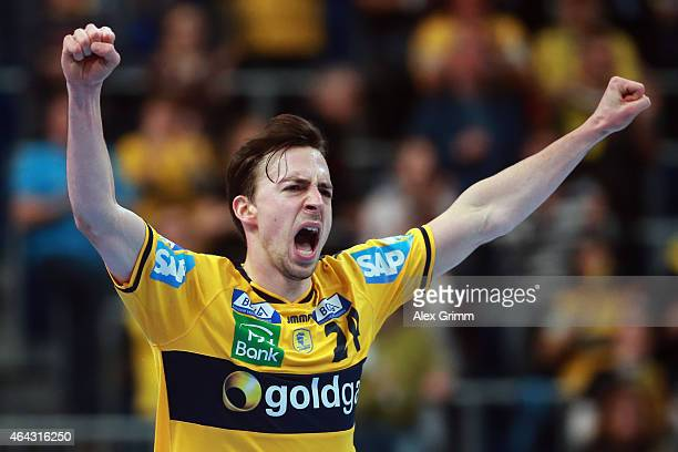 Patrick Groetzki of RheinNeckar Loewen celebrates a goal during the DKB Handball Bundesliga match between RheinNeckar Loewen and SG BBM Bietigheim at...