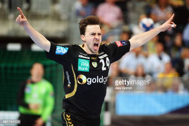 Patrick Groetzki of RheinNeckar Loewen celebrates a goal during the Velux EHF Champions League Round of 16 second leg match between RheinNeckar...