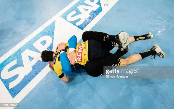 Patrick Groetzki of RheinNeckar Loewen celebrates with goaltender Mikael Appelgren of RheinNeckar Loewen after the DKB HBL match between RheinNeckar...