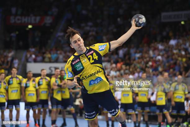 Patrick Groetzki of RheinNeckar Loewen scores the winning goal of the penalty shoutout for the Pixum DHB Handball Super Cup 2017 between RheinNeckar...
